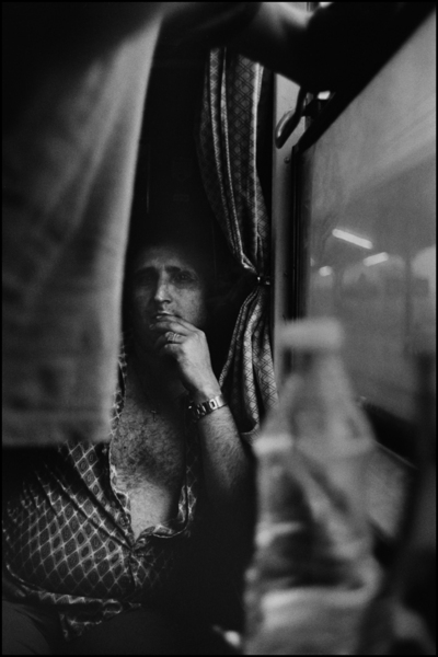 Man on train : Structured Moments : SUSAN MAY TELL: Photographs of Space, Silence & Solitude
