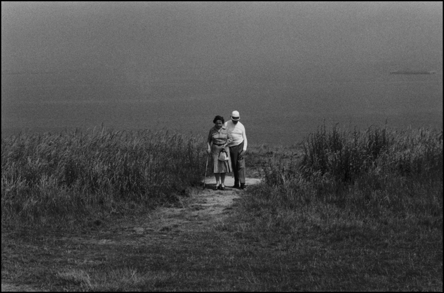 Couple on the beach in summer, Normandy : Structured Moments : SUSAN MAY TELL: Photographs of Space, Silence & Solitude